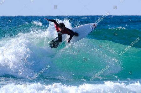 Stock Photo of Seth Morris surfing in the Men's Open Final at the Caravan & Motorhome Club English National Surfing Championships held at Perranporth.