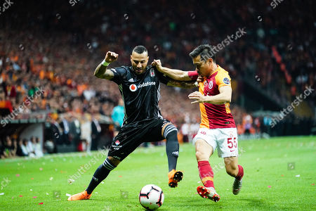 Yuto Nagatomo of Galatasaray and Ricardo Quaresma of Besiktas challenging for the ball during the Turkish Super Lig match between Galatasaray S.K. and Besiktas at the Türk Telekom Arena in Istanbul , Turkey
