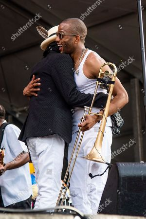 Cyril Neville, Trombone Shorty. Cyril Neville, left, and Trombone Shorty perform at the New Orleans Jazz and Heritage Festival, in New Orleans