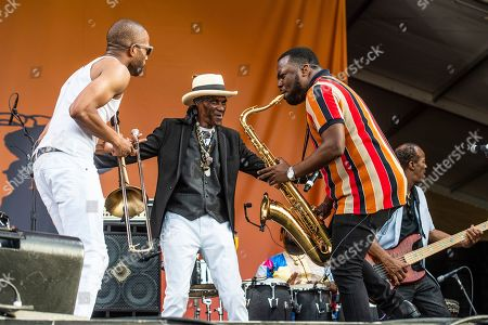Trombone Shorty, Cyril Neville. Trombone Shorty, left, and Cyril Neville perform at the New Orleans Jazz and Heritage Festival, in New Orleans