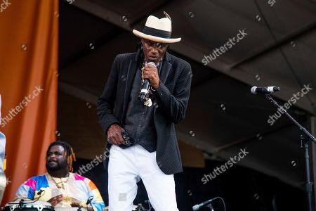 Stock Photo of Cyril Neville performs at the New Orleans Jazz and Heritage Festival, in New Orleans