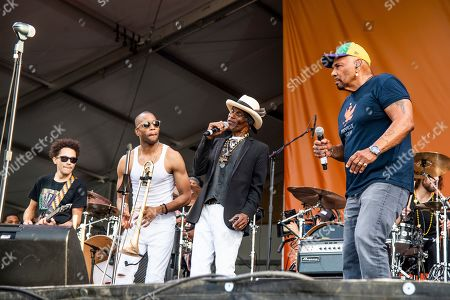 Stock Picture of Trombone Shorty, Cyril Neville, Ivan Neville. Trombone Shorty, from left, Cyril Neville, and Ivan Neville perform at the New Orleans Jazz and Heritage Festival, in New Orleans