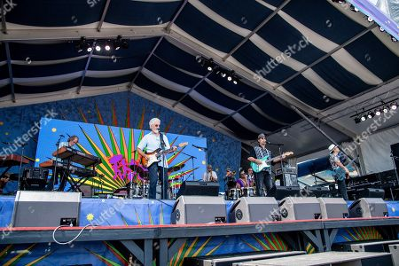 Bill Payne, Paul Barrere, Fred Tackett, Kenny Gradney. Bill Payne, from left, Paul Barrere, Fred Tackett, and Kenny Gradney of Little Feat perform at the New Orleans Jazz and Heritage Festival, in New Orleans