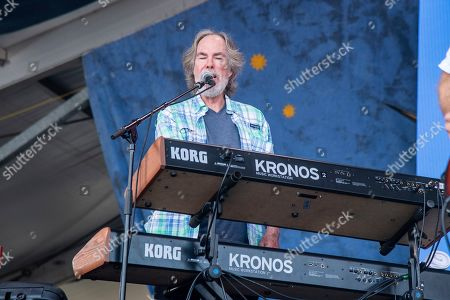 Stock Photo of Bill Payne of Little Feat performs at the New Orleans Jazz and Heritage Festival, in New Orleans