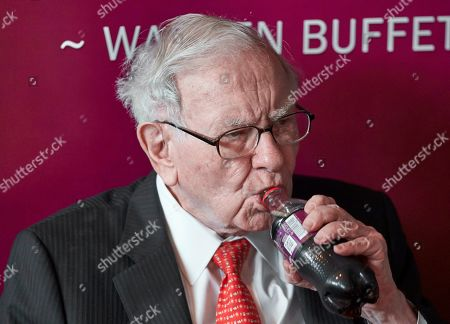 Warren Buffett, Chairman and CEO of Berkshire Hathaway, takes a sip of Cherry Coke during a game of bridge following the annual Berkshire Hathaway shareholders meeting in Omaha, Neb
