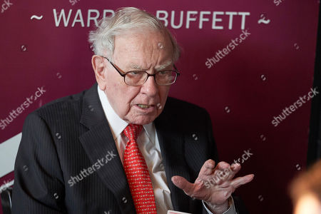 Warren Buffett, Chairman and CEO of Berkshire Hathaway, gestures during a game of bridge following the annual Berkshire Hathaway shareholders meeting in Omaha, Neb