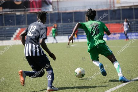 Stock Picture of Katric FC  player, Bobby Williams (R)  control a ball   during a 1st division match betwen Katric FC and Nimba United at The Liberia Football Association First Division (LFA) Orange National Football   2019 League at the Antoinette Tubman Stadium in Monrovia, Liberia, 05 March 2019.