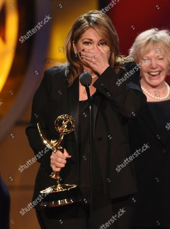 "Valerie Bertinelli reacts as she accepts the award for outstanding culinary program for ""Valerie's Home Cooking"" at the 46th annual Daytime Emmy Awards at the Pasadena Civic Center, in Pasadena, Calif"
