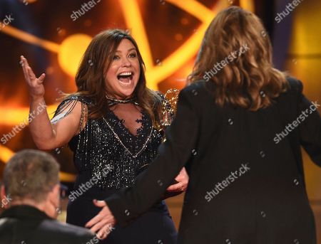 "Valerie Bertinelli, Rachael Ray. Rachael Ray, left, reacts as she presents Valerie Bertinelli with the award for outstanding culinary program for ""Valerie's Home Cooking"" at the 46th annual Daytime Emmy Awards at the Pasadena Civic Center, in Pasadena, Calif"