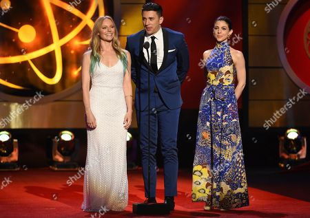 Stock Image of Marci Miller, Billy Flynn, Kate Mansi. Marci Miller, from left, Billy Flynn and Kate Mansi present the award for outstanding supporting actress in a drama series at the 46th annual Daytime Emmy Awards at the Pasadena Civic Center, in Pasadena, Calif