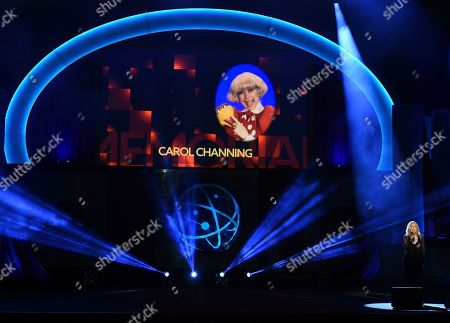 Stock Image of Roslyn Kind, Carol Channing. Roslyn Kind performs during an In Memoriam tribute at the 46th annual Daytime Emmy Awards at the Pasadena Civic Center, in Pasadena, Calif. An image of Carol Channing appears onscreen