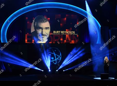 Roslyn Kind, Burt Reynolds. Roslyn Kind performs during an In Memoriam tribute at the 46th annual Daytime Emmy Awards at the Pasadena Civic Center, in Pasadena, Calif. An image of Burt Reynolds appears onscreen