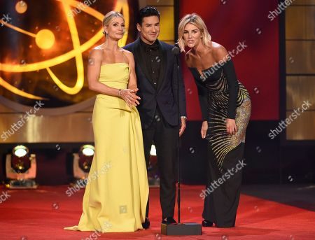 Dayna Devon, Mario Lopez, Charissa Thompson. Dayna Devon, from left, Mario Lopez and Charissa Thompson present a 25th anniversary tribute to Extra at the 46th annual Daytime Emmy Awards at the Pasadena Civic Center, in Pasadena, Calif