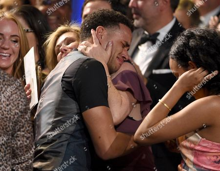 """Kyler Pettis reacts in the audience as he is announced winner of the award for outstanding younger actor in a drama series for """"Days of Our Lives"""" at the 46th annual Daytime Emmy Awards at the Pasadena Civic Center, in Pasadena, Calif"""