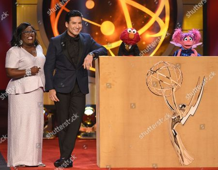 Sheryl Underwood, Mario Lopez. Hosts Sheryl Underwood, left, and Mario Lopez speak onstage with the Muppets Elmo and Abby Cadabby at the 46th annual Daytime Emmy Awards at the Pasadena Civic Center, in Pasadena, Calif