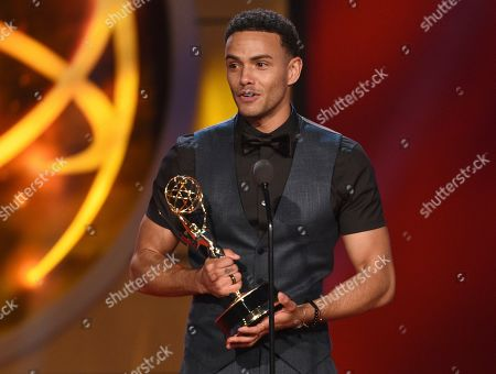 """Kyler Pettis accepts the award for outstanding younger actor in a drama series for """"Days of Our Lives"""" at the 46th annual Daytime Emmy Awards at the Pasadena Civic Center, in Pasadena, Calif"""