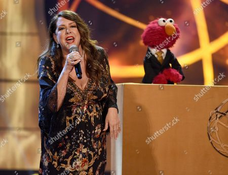 Joely Fisher, Elmo. Joely Fisher, left, performs with Elmo the Muppet at the 46th annual Daytime Emmy Awards at the Pasadena Civic Center, in Pasadena, Calif