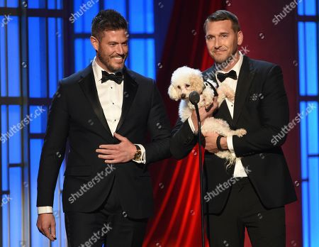 Jesse Palmer, Brandon McMillan. Jesse Palmer, left, and Brandon McMillan, while holding a dog, present the award for outstanding entertainment talk show host at the 46th annual Daytime Emmy Awards at the Pasadena Civic Center, in Pasadena, Calif