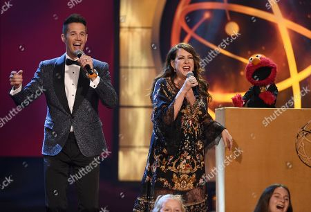 David Osmond, Joely Fisher, Elmo. David Osmond, from left, Joely Fisher, and Elmo sing on stage at the 46th annual Daytime Emmy Awards at the Pasadena Civic Center, in Pasadena, Calif