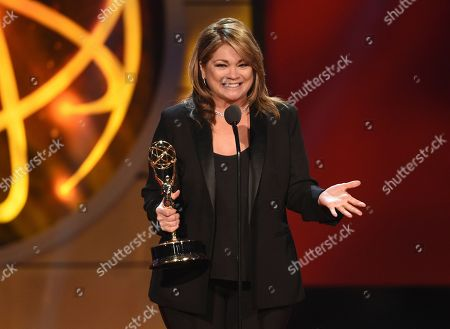 "Valerie Bertinelli accepts the award for outstanding culinary host for ""Valerie's Home Cooking"" at the 46th annual Daytime Emmy Awards at the Pasadena Civic Center, in Pasadena, Calif"