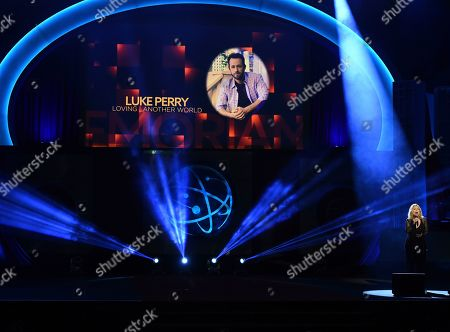Roslyn Kind, Luke Perry. Roslyn Kind performs during the In Memoriam. Luke Perry appears on screen at the 46th annual Daytime Emmy Awards at the Pasadena Civic Center, in Pasadena, Calif