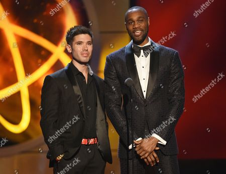 Kristos Andrews, James Bland. Kristos Andrews, left, and James Bland present the award for outstanding informative talk show host at the 46th annual Daytime Emmy Awards at the Pasadena Civic Center, in Pasadena, Calif