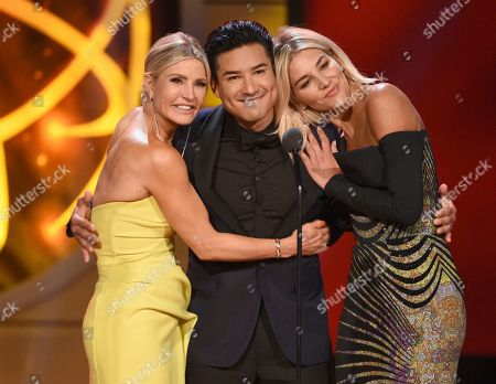 Dayna Devon, Mario Lopez, Charissa Thompson. Dayna Devon, left, Mario Lopez, and Charissa Thompson present a 25th anniversary tribute to Extra at the 46th annual Daytime Emmy Awards at the Pasadena Civic Center, in Pasadena, Calif