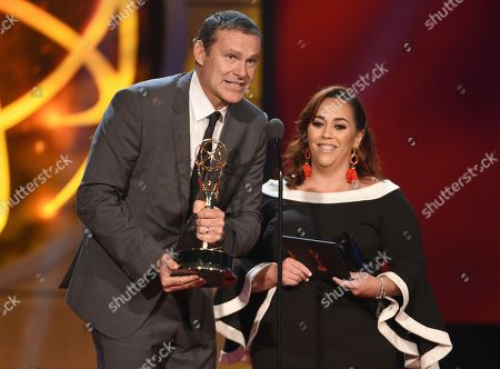 """Alan Tacher, Gilcia Marquez-Pronesti. Alan Tacher, left, and Glicia Marquez-Pronesti accept the award for outstanding morning program in Spanish for """"Despierta America"""" at the 46th annual Daytime Emmy Awards at the Pasadena Civic Center, in Pasadena, Calif"""