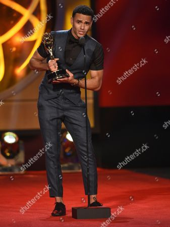 """Kyler Pettis accepts the award for outstanding younger actor in a drama series for """"Days of Our Lives,"""" at the 46th annual Daytime Emmy Awards at the Pasadena Civic Center, in Pasadena, Calif"""