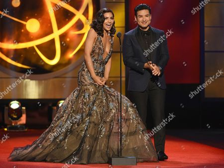 Camila Banu, Mario Lopez. Camila Banus, left, and host Mario Lopez present the award for outstanding entertainment program in Spanish at the 46th annual Daytime Emmy Awards at the Pasadena Civic Center, in Pasadena, Calif