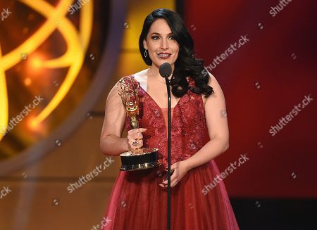 """Alejandra Oraa accepts the award for outstanding daytime talent in a Spanish language program for """"Destinos,"""" at the 46th annual Daytime Emmy Awards at the Pasadena Civic Center, in Pasadena, Calif"""