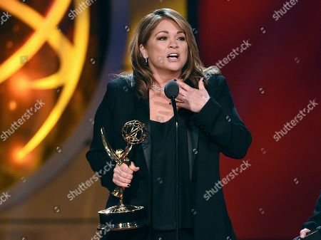 "Valerie Bertinelli accepts the award for outstanding culinary program for ""Valerie's Home Cooking,"" at the 46th annual Daytime Emmy Awards at the Pasadena Civic Center, in Pasadena, Calif"