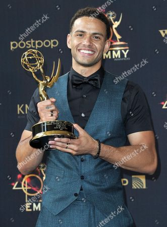 """Kyler Pettis poses in the press room with the award for outstanding younger actor in a drama series for """"Days of Our Lives"""" at the 46th annual Daytime Emmy Awards at the Pasadena Civic Center, in Pasadena, Calif"""