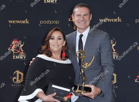 """Alan Tacher, Glicia Marquez-Pronesti. Glicia Marquez-Pronesti, left, and Alan Tacher pose in the press room with the award for outstanding morning program in Spanish for """"Despierta America"""" at the 46th annual Daytime Emmy Awards at the Pasadena Civic Center, in Pasadena, Calif"""