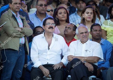 Stock Picture of The Former President of Honduras Manuel Zelaya (2-L, first row) and former President of Colombia Ernesto Samper (2-R, first row), look on as Former President of the Dominican Republic and President of the ruling Dominican Liberation Party (PLD) Leonel Fernandez (not pictured) speaks during an event in Santo Domingo, Dominican Republic, 05 May 2019. During the event Fernandez reiterated his rejection of an possible constitutional reform that allows President Danilo Medina to opt for a third consecutive term in 2020.