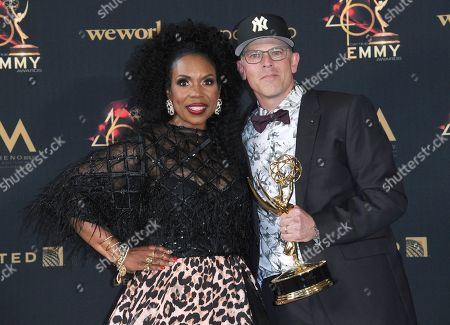 "Lauren Lake, David Armour. Lauren Lake, left, and David Armour pose in the press room with the award for outstanding legal/courtroom program for ""Lauren Lake's Paternity Court"" at the 46th annual Daytime Emmy Awards at the Pasadena Civic Center, in Pasadena, Calif"