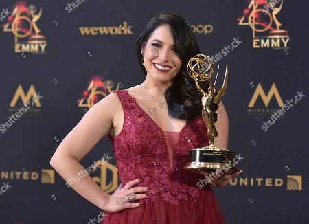 """Alejandra Oraa poses in the press room with the award for outstanding daytime talent in a Spanish language program for """"Destinos,"""" at the 46th annual Daytime Emmy Awards at the Pasadena Civic Center, in Pasadena, Calif"""