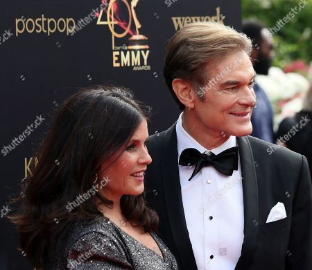 Lisa Oz (L) with her husband Dr. Mehmet Oz arrive at the 46th annual Daytime Emmy Awards at the Pasadena Civic Center in Pasadena, California, USA, 05 May 2019.