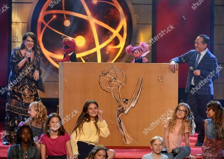Stock Image of Joely Fisher, Elmo, Abby Cadabby, Alan Muraoka. Alan Muraoka, right, and Joely Fisher, left, perform with Muppets Elmo and Abby Cadabby at the 46th annual Daytime Emmy Awards at the Pasadena Civic Center, in Pasadena, Calif