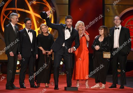 """Jesse Palmer, center, accepts the award for outstanding entertainment news program for """"DailyMailTV"""" with the cast and crew at the 46th annual Daytime Emmy Awards at the Pasadena Civic Center, in Pasadena, Calif"""
