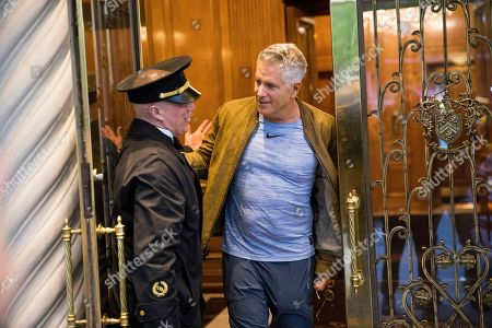 Donny Deutsch talks with a doorman after visiting Michael Cohen, President Donald Trump's former personal attorney, in his Park Avenue apartment, in New York