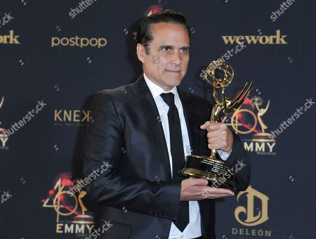 """Maurice Benard poses in the press room with the award for outstanding lead actor in a drama series for """"General Hospital"""" at the 46th annual Daytime Emmy Awards at the Pasadena Civic Center, in Pasadena, Calif"""