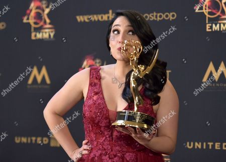 """Alejandra Oraa poses in the press room with the award for outstanding daytime talent in a Spanish language program for """"Destinos"""" at the 46th annual Daytime Emmy Awards at the Pasadena Civic Center, in Pasadena, Calif"""