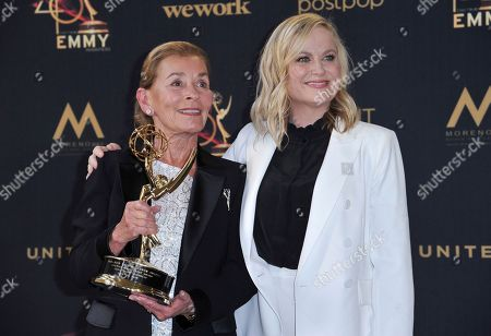 Judy Sheindlin, Amy Poehler. Lifetime achievement award winner Judge Judy Sheindlin, left, and Amy Poehler pose in the press room at the 46th annual Daytime Emmy Awards at the Pasadena Civic Center, in Pasadena, Calif