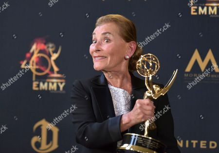 Lifetime achievement award winner Judge Judy Sheindlin poses in the press room at the 46th annual Daytime Emmy Awards at the Pasadena Civic Center, in Pasadena, Calif