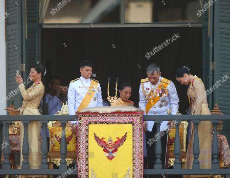 Members of the Thai royal family (L-R) Princess Sirivannavari Nariratana, Prince Dipangkorn Rasmijoti, Princess Bajrakitiyabha, King Maha Vajiralongkorn Bodindradebayavarangkun and Queen Suthida appear a balcony of the Suddhaisavarya Prasad Hall in the Grand Palace as part of the monarch's the royal coronation ceremony in Bangkok, Thailand, 06 May 2019. The three-day ancient elaborate traditional coronation ceremonies of Thai King Maha Vajiralongkorn is a formal ceremony to complete the monarch's accession to the throne.