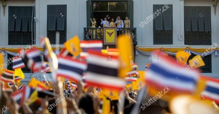 Members of the Thai royal family (L-R) Princess Sirivannavari Nariratana, Prince Dipangkorn Rasmijoti, Princess Bajrakitiyabha, King Maha Vajiralongkorn Bodindradebayavarangkun and Queen Suthida appear to the public on a balcony of the Suddhaisavarya Prasad Hall in the Grand Palace as part of the monarch's the royal coronation ceremony in Bangkok, Thailand, 06 May 2019. The three-day ancient elaborate traditional coronation ceremonies of Thai King Maha Vajiralongkorn is a formal ceremony to complete the monarch's accession to the throne.