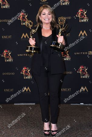 "Valerie Bertinelli poses in the press room with the awards for outstanding culinary program and outstanding culinary host for ""Valerie's Home Cooking"" at the 46th annual Daytime Emmy Awards at the Pasadena Civic Center, in Pasadena, Calif"