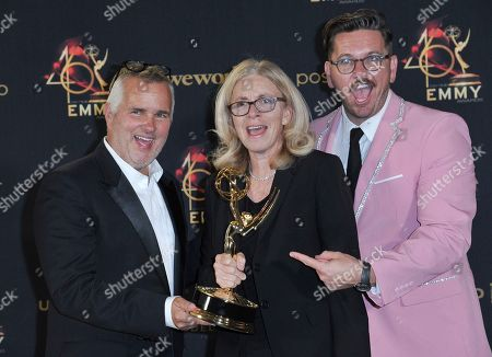 """Ed Glavin, Mary Connelly, Kevin Leman. Ed Glavin, from left, Mary Connelly and Kevin Leman pose in the press room with the award for outstanding entertainment talk show for """"The Ellen DeGeneres Show"""" at the 46th annual Daytime Emmy Awards at the Pasadena Civic Center, in Pasadena, Calif"""