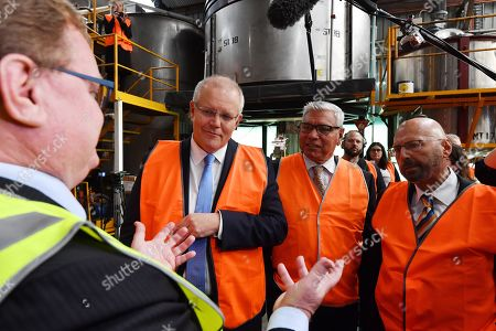 Australian Prime Minister Scott Morrison (2-L) is joined by candidate for Gilmore Warren Mundine (C) and Senator Arthur Sinodinos (R) during a visit to the Nowchem factory in Nowra, in the electorate of Gilmore, south of Sydney, Australia, 06 May 2019. A federal election will be held in Australia on 18 May 2019.